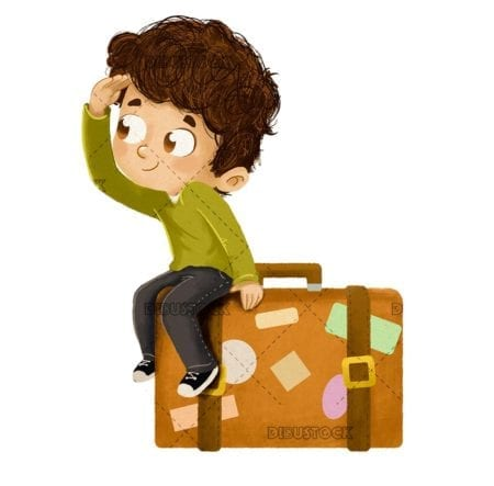 Boy on vacation sitting in a suitcase