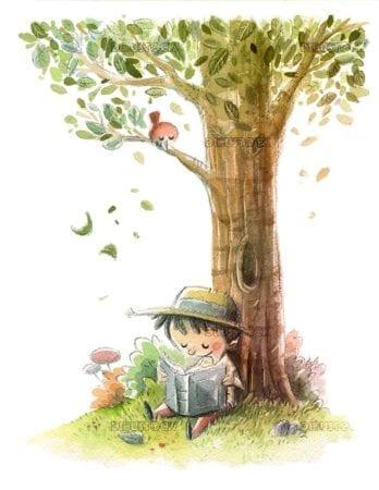Boy reading under a tree