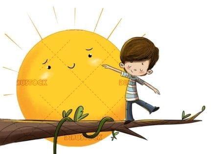 Child balancing on a tree branch with sunshine in the background