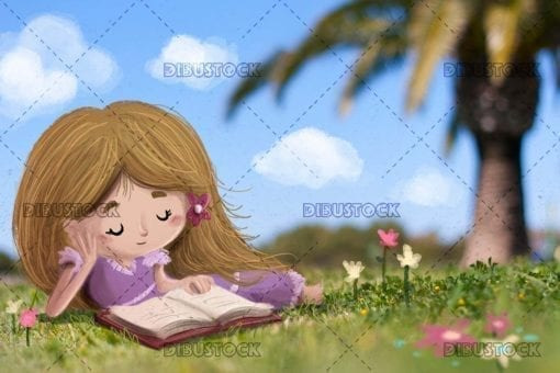 Little girl lying in the field reading a book