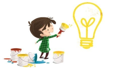 Boy with brush and paint painting a light bulb as an idea