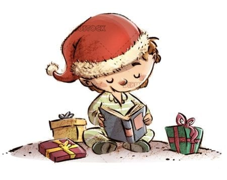 boy reading a book surrounded by gifts at christmas