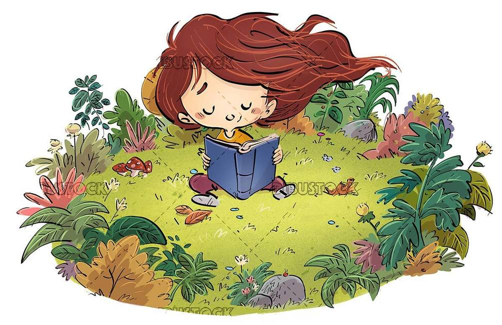 Happy little girl reading a book sitting in a field with flowers