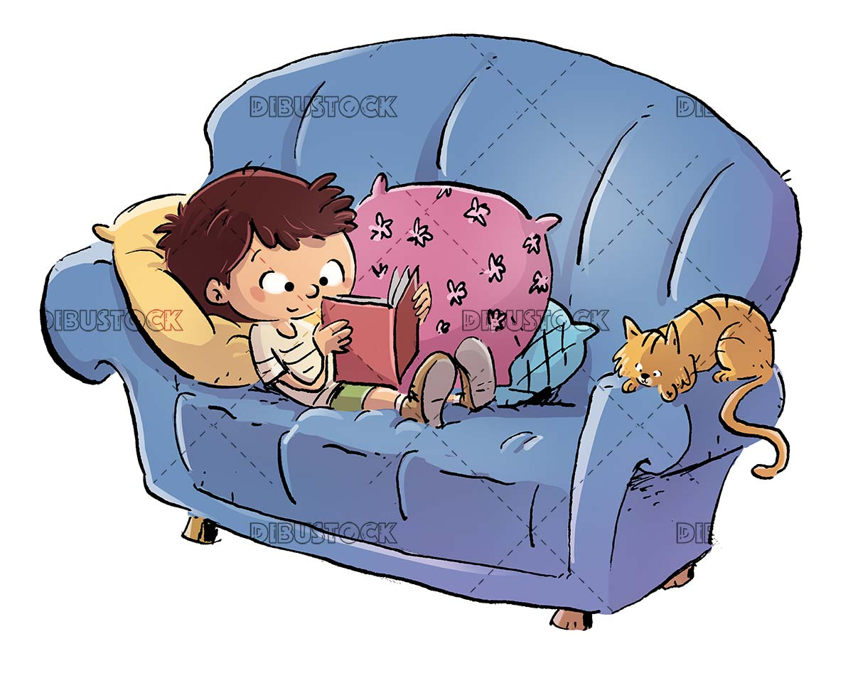 boy reading on the couch with his cat beside