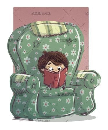 boy sitting in a green armchair reading a book
