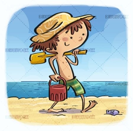 boy walking on the beach with bucket and shovel