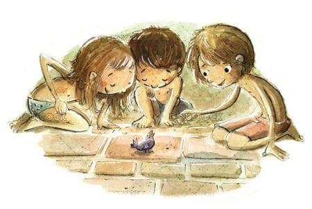 children feeding a little bird