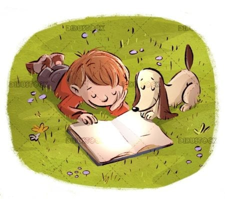 dog and boy reading an open books in the field