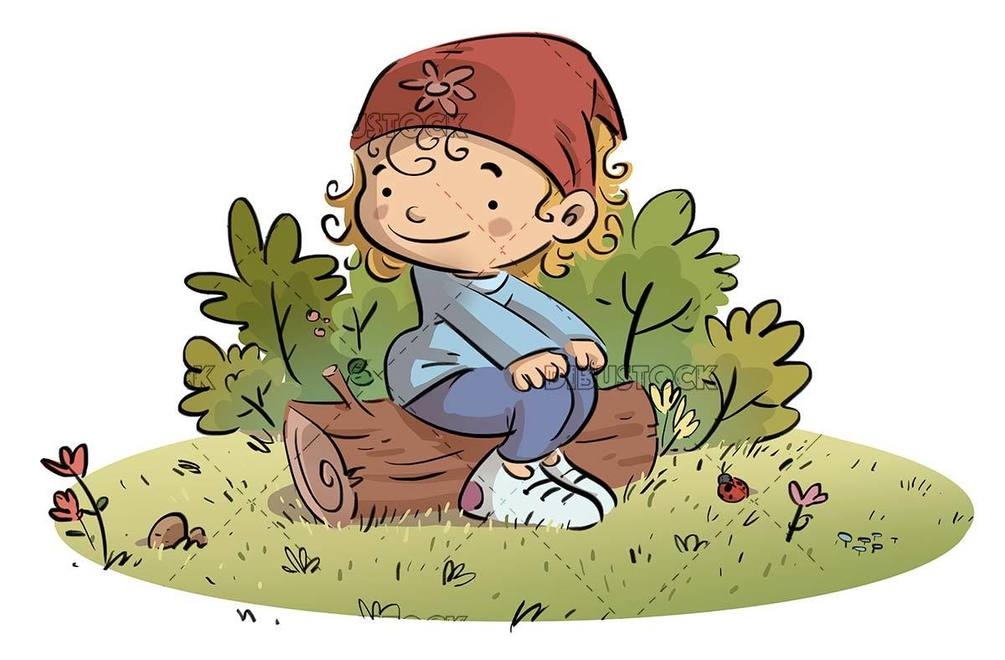 girl with headscarf sitting on a log in the field