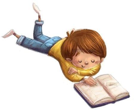happy boy lying while reading