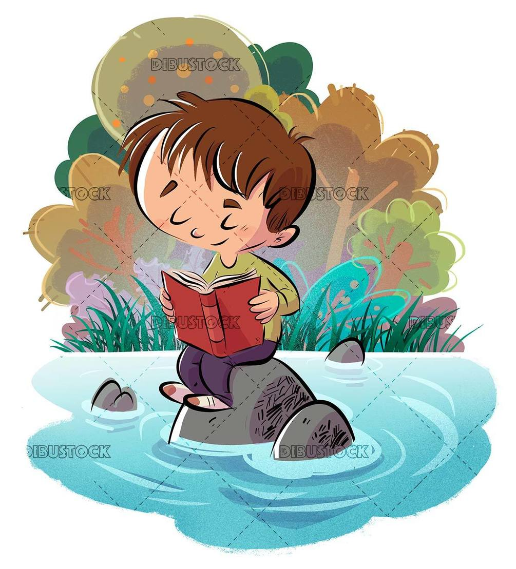 happy boy reading a book sitting on stones in the water