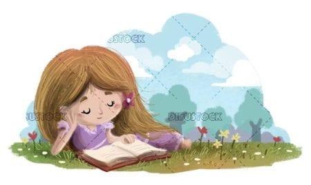 Little girl lying in a flower field reading a book