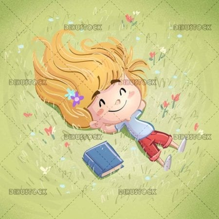 little girl lying happy in the field with book beside
