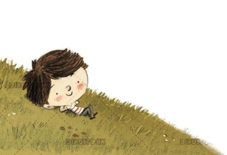 relaxed boy lying in the meadow