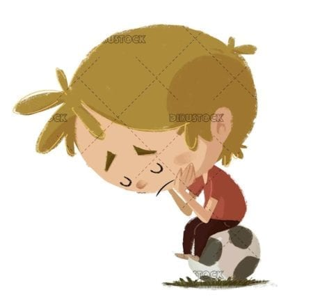 sad boy sitting on top of a soccer ball