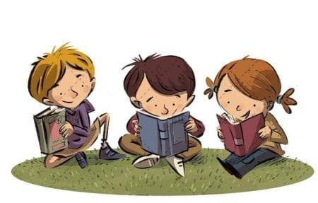 three children reading books in sitting on the grass