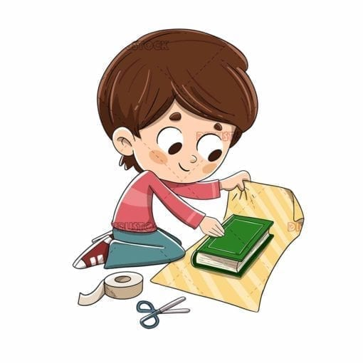 Boy wrapping a book with gift wrapping paper low