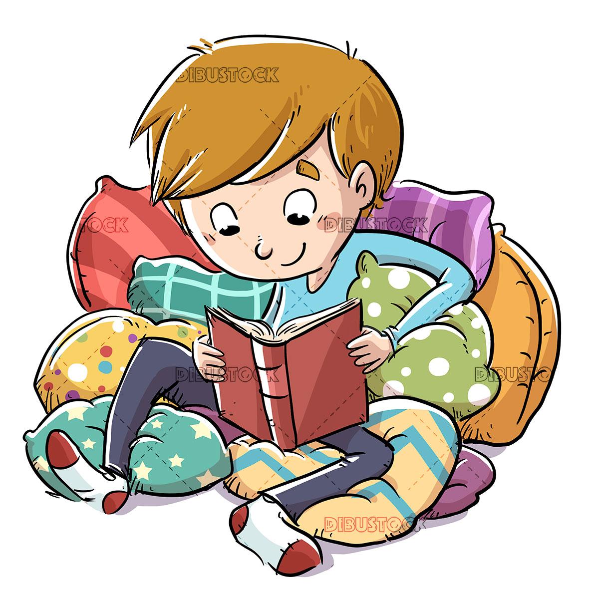 Boy between cushions reading a book
