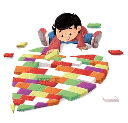 boy making a heart with toys
